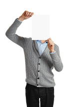 Man holding a blank page in front of his face.