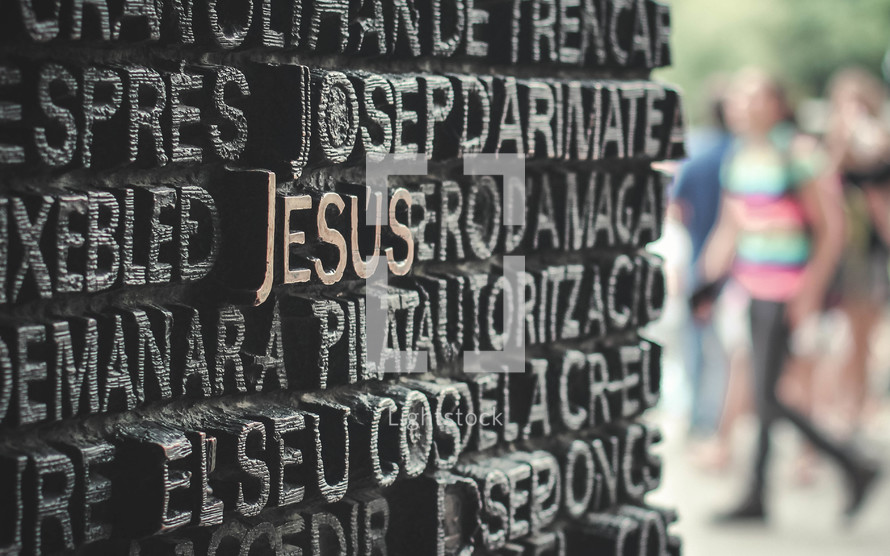 word Jesus carved on a monument