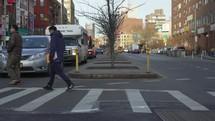 people using a crosswalk in NYC