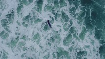 Birdseye shot of surfer paddling out to the ocean - Surf Shoot