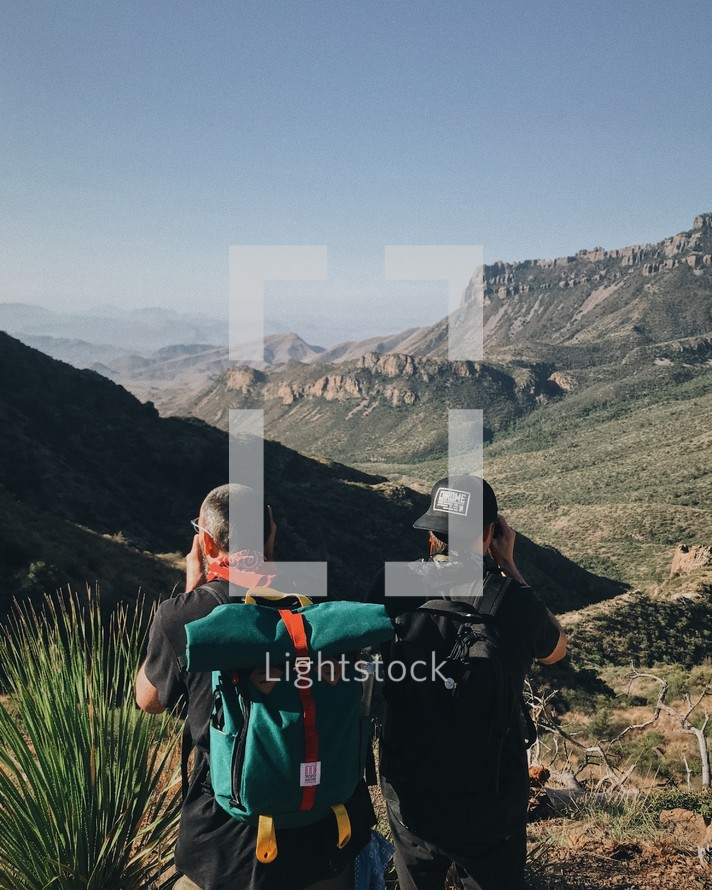 men hiking a canyon