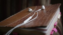 earbuds on a Bible Reading an audio bible