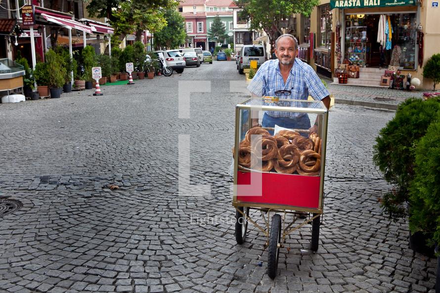 man pushing a bread cart