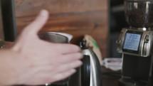 barista brewing coffee