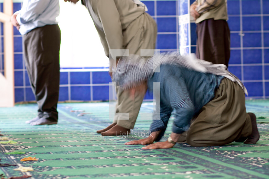 Kurdish man praying at Mosque in southeast Turkey