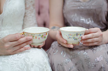 bride and bridesmaid with tea cups