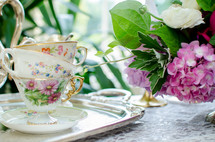 tea cups on a silver tray