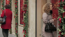 a woman enjoying Christmas decorations