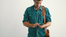 a man listening to his phone with earbuds