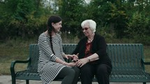older woman mentoring a young woman