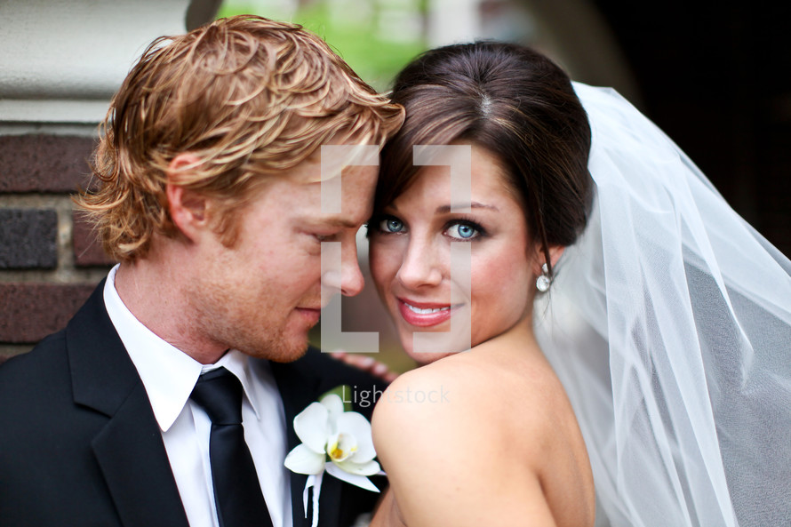 happy bride and her groom