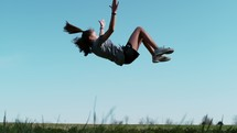 slow motion of a girl doing a back flip