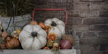 fall decorations in a wooden wagon