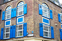 blue shutters on a brick building