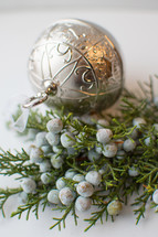 juniper with berries and ornament
