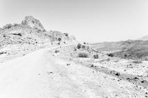 dirt road through a desert landscape