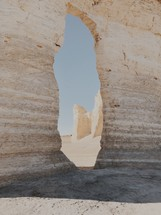 a rock formation in a desert at sunset