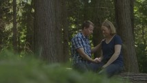 a couple praying together in the woods
