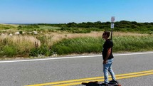 skater on a coastal highway