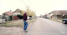 a man walking out onto street