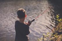 boy child fishing in a lake