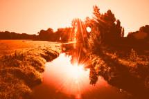 sunburst on a pond
