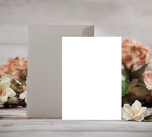 blank white envelope and card with flowers