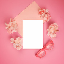 pink background and white envelope