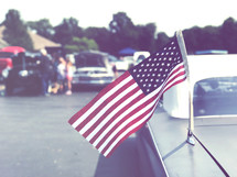 American flag on a car antenna