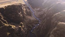 drone flying over a canyon river