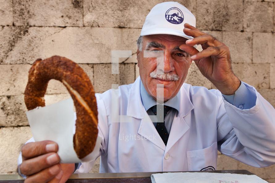 Muslim, Turk, Turkish man offering Simit