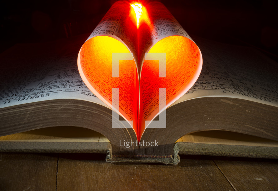glowing heart from the pages of a Bible
