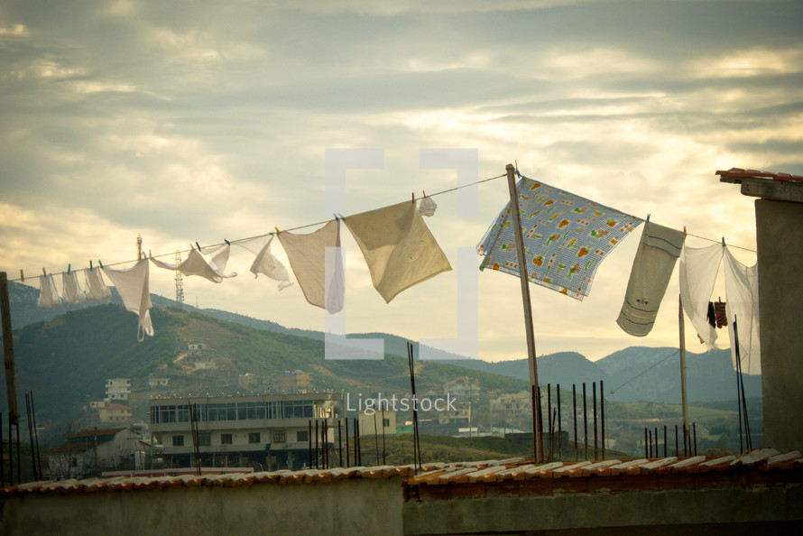 Laundry hanging on a clothesline blowing in the wind.