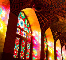 sunlight shining through stained glass windows into a mosque in the Philippines
