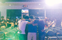 friends comforting each other and praying