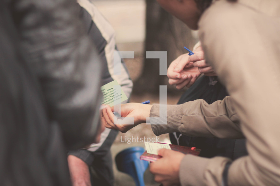 people passing out business cards
