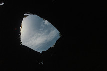 view of the sky from a hole