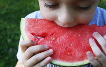 a child eating a watermelon