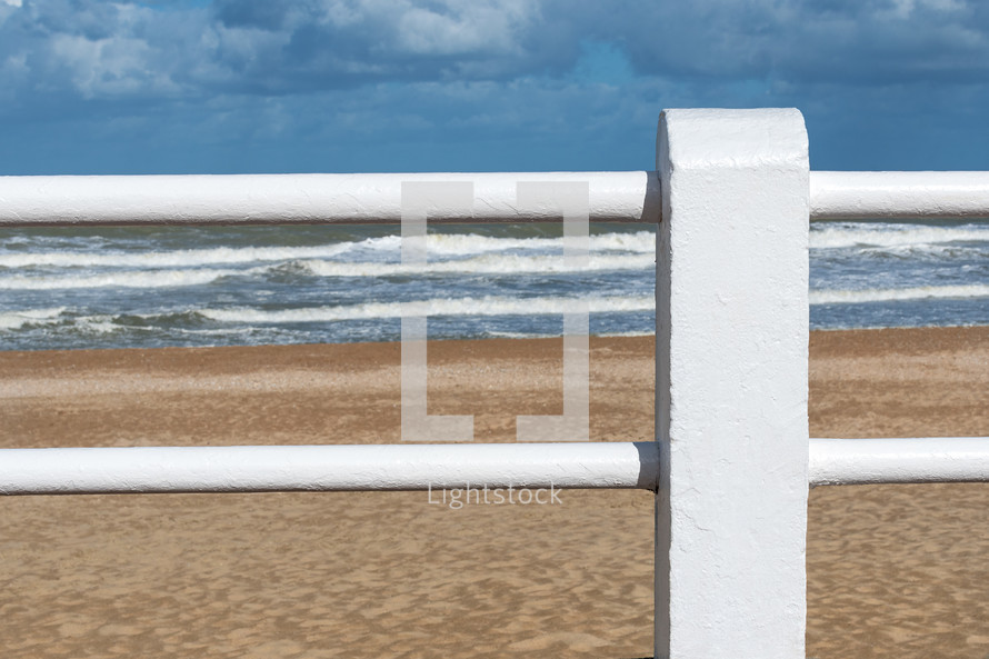 fence and ocean view