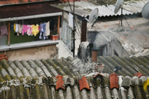 metal shingles on a roof and clothes on a clotheslines in Turkey