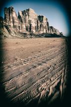 tire tracks in desert sands