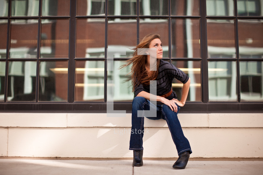 woman sitting and looking to the side