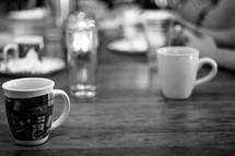 mugs on a wood table