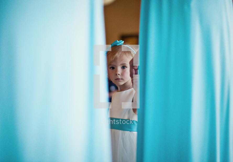 flower girl through teal bridesmaid dresses