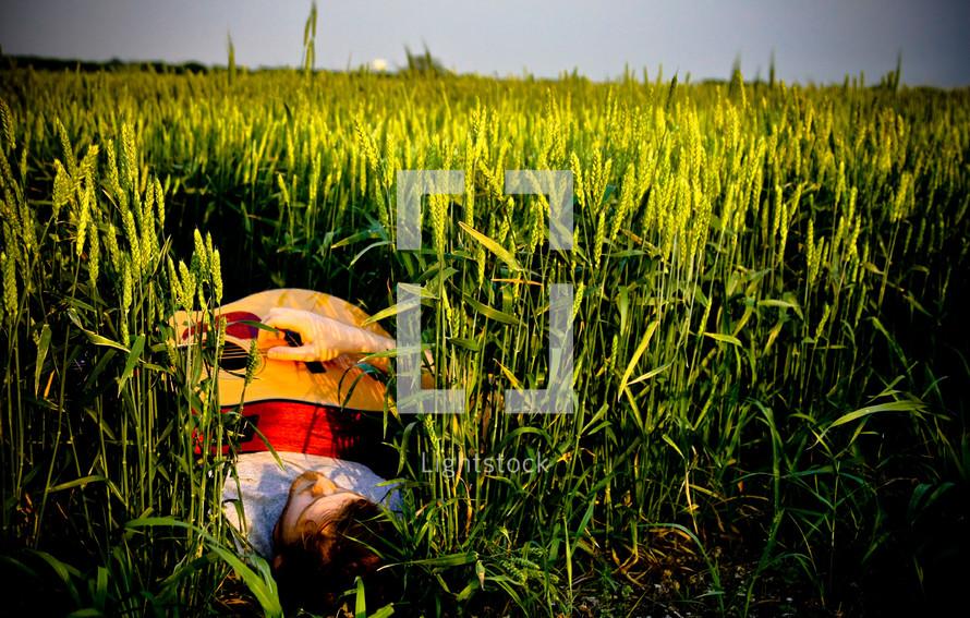 man sleeping in a wheat field