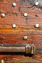 brass hardware on a wood door