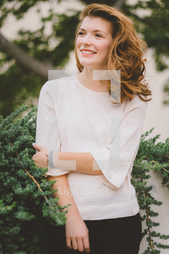 portrait of a young woman standing outdoors
