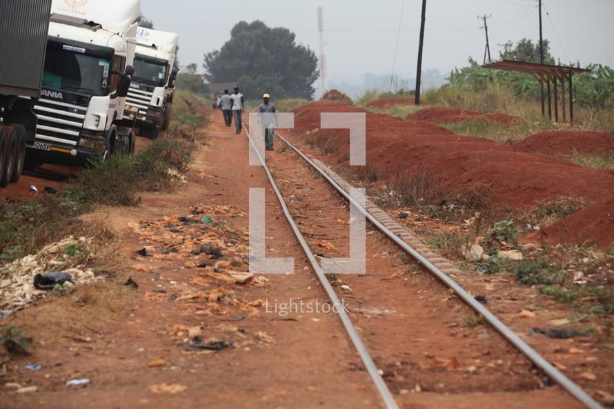 workers walking on railroad tracks