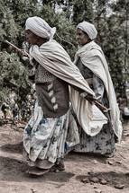 women walking to a celebration in Ethiopia