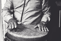 hands on a bongo drum